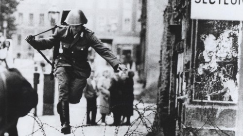 Late August 1961. An East German guard jumps to freedom in West Berlin.